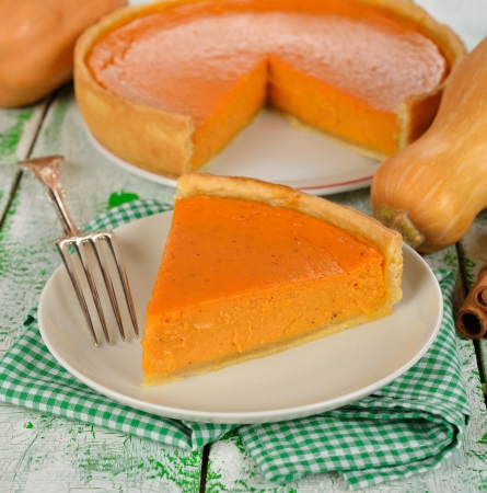 slice of pumpkin pie on a white table Stock Photo - 22439733