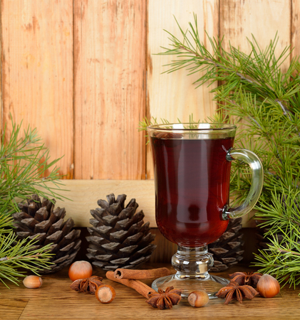 Christmas mulled wine and green twigs on a brown background photo