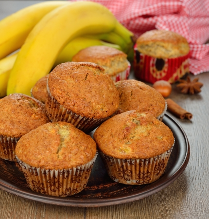 banana muffins on a brown background Stock Photo