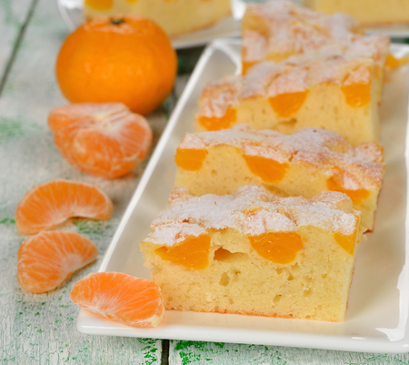 Cake with mandarin oranges on a white