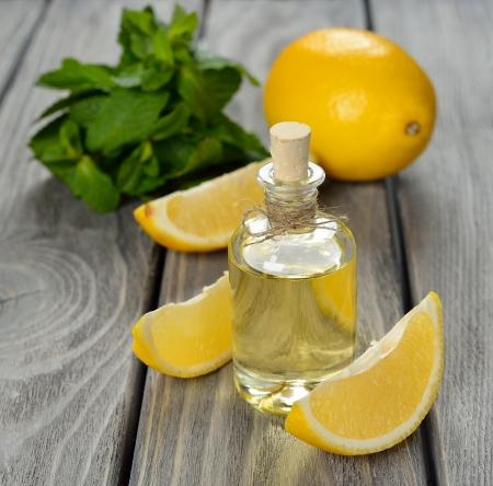 Lemon essential oil on a gray