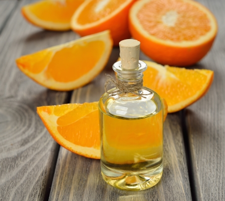 Orange essential oil on a gray