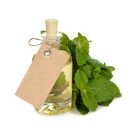 Peppermint essential oil on white