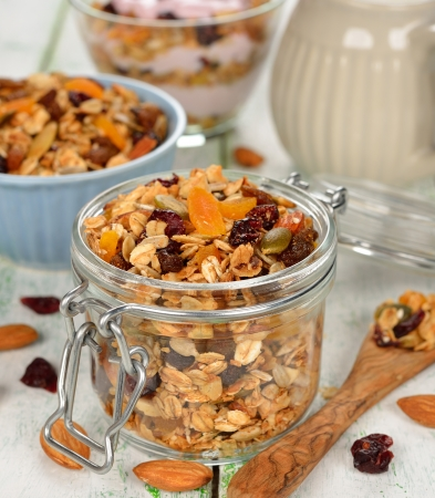 Granola with fruit and nuts on white background Stock Photo