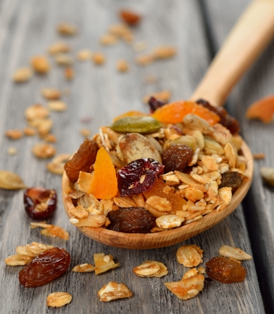 Granola with fruit and nuts on gray background Stock Photo