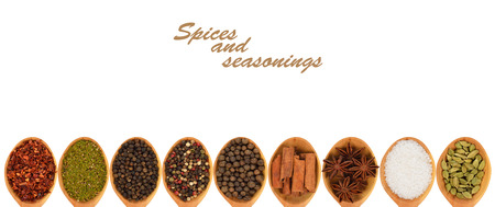 Spices and seasonings in wooden spoons  photo