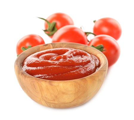 Tomato ketchup isolated on white  photo