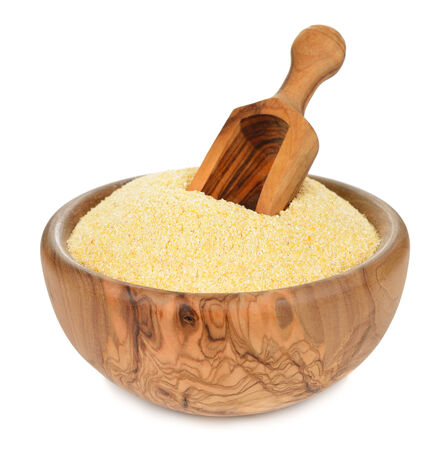 corn flour in a wooden bowl isolated on white background Stock Photo