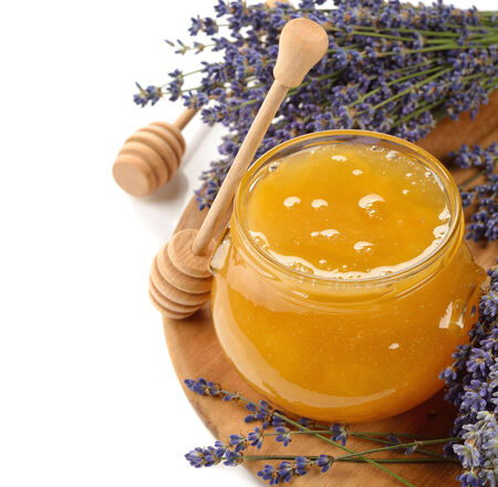 Honey with lavender on white  photo