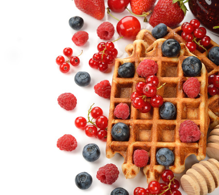 liege: Liege waffles with berries on white background Stock Photo