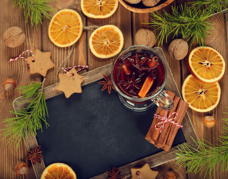 Christmas mulled wine on brown background Stock Photo