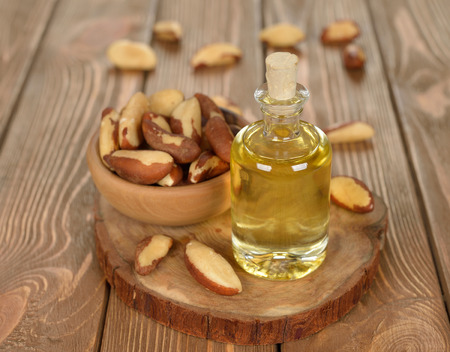 Brazil nut oil on brown background