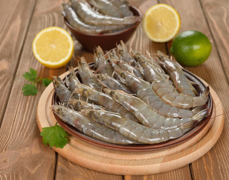 Raw shrimp on brown plate