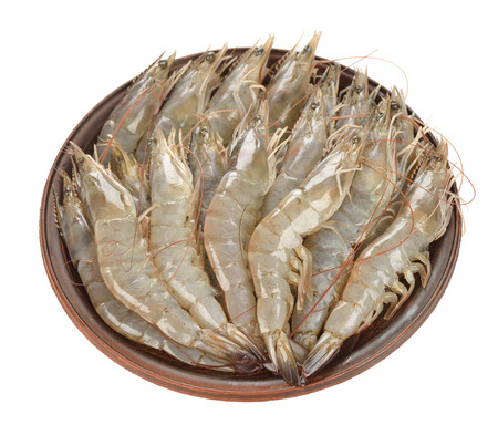 Raw shrimp on brown plate, isolated on white background Stock Photo