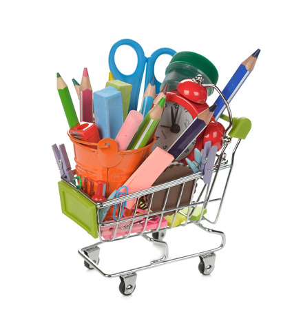 Shopping cart filled with colorful school supplies, isolated on white background Stock Photo