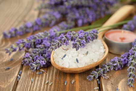 unconventional: Sea salt with lavender on brown background