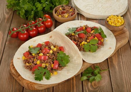 Mexican burritos on a brown background