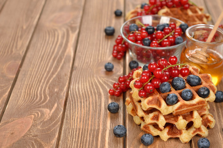 liege: Liege waffles with berries on brown background Stock Photo