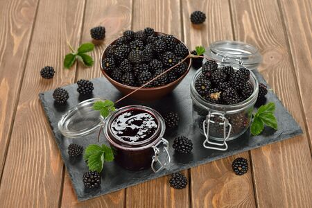 preserving: Blackberry jam on a brown background