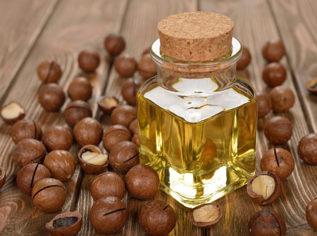 Macadamia nut oil on a brown background