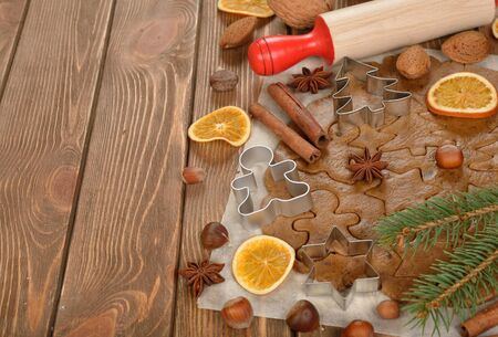 man nuts: Ingredients to bake Christmas cookies on a brown background