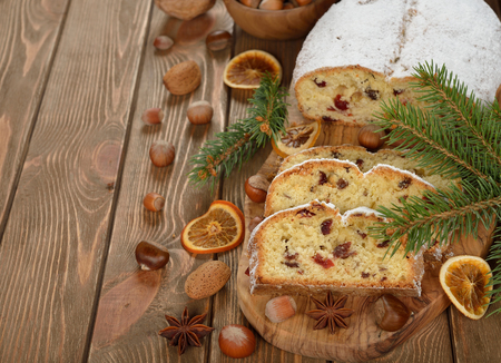 stollen: Traditional Christmas Stollen on a brown background Stock Photo