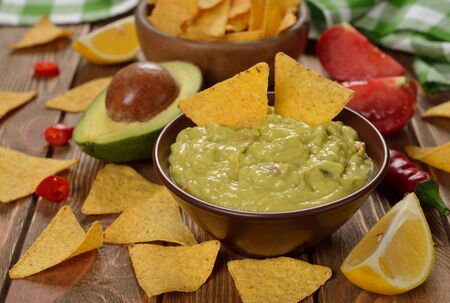 filled: Traditional guacamole sauce on a brown background