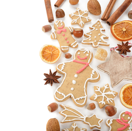 nuts: Gingerbread man, nuts and spices on a white background Stock Photo