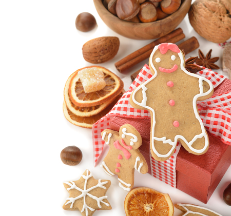 man nuts: Gingerbread man, nuts and spices on a white background Stock Photo