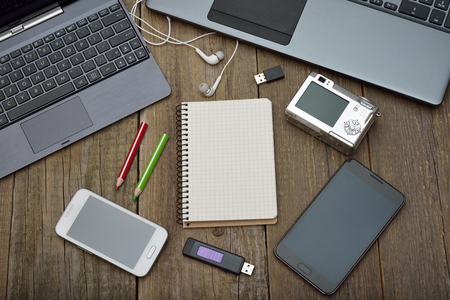 Laptop, tablet and mobile phone on a wooden background Stock Photo