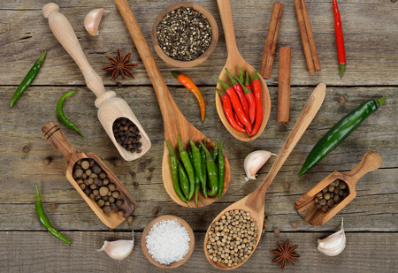 seasonings: Various spices and seasonings on a wooden background