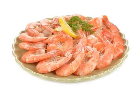 Boiled shrimp with lemon on white background