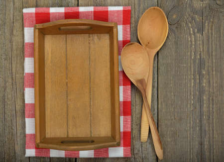 sample tray: Wooden tray and spoons on a brown background