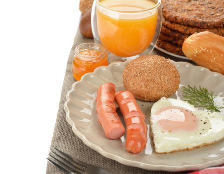 scrambled eggs: Scrambled eggs with sausage for breakfast on a white background Foto de archivo