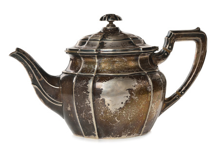 antique dishes: Vintage silver teapot isolated on white background Stock Photo