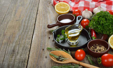 seasonings: Frying pan, spices and seasonings on a wooden background Stock Photo