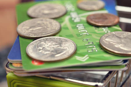 accumulation: Credit card and coins macro photography