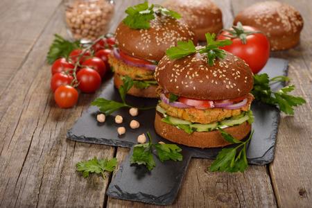 vegetarian hamburger: Vegetarian burger on a wooden background Stock Photo