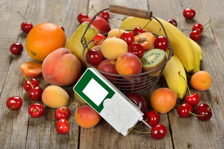 the tester: Nitrate tester and various fruits on wooden background Stock Photo