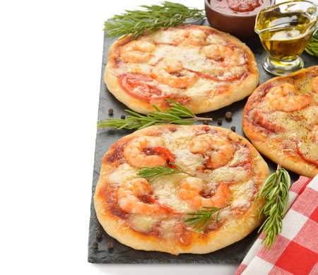 mini pizza: Mini pizza with shrimp and rosemary on a white background