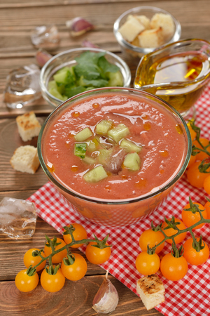 gazpacho: Cold soup gazpacho with yellow tomatoes on a brown background Stock Photo