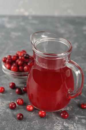 cranberry juice: Natural cranberry juice on a gray background Stock Photo