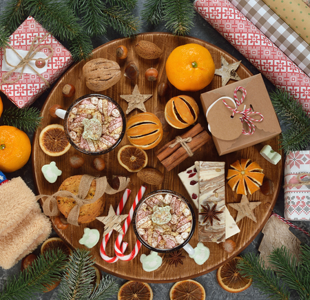 Various Christmas sweets on a brown background