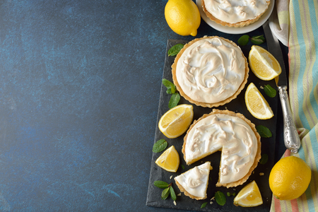 Lemon pie with meringue on a blue background Reklamní fotografie