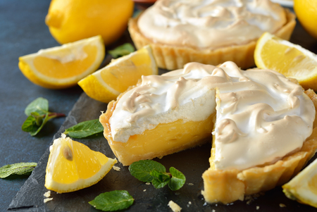 Lemon pie with meringue on a blue background Stock Photo