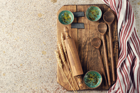 Vintage utensils on a brown background, baking concept