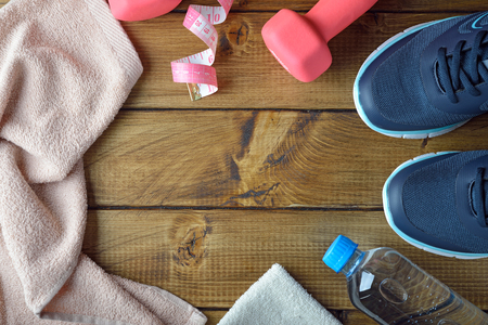 Items for sports on a brown background, fitness concept