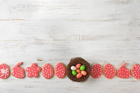 Easter sweets and decorations on a white background