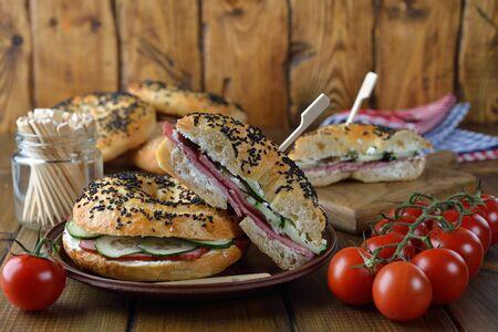 Bagel sandwich on brown background