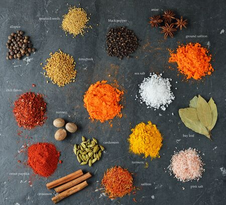 Various oriental spices and seasonings on dark background